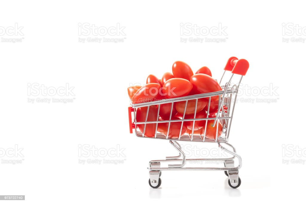 Red tomatoes in shopping cart. Healthy food for good healt. Vegetables shopping concept. stock photo