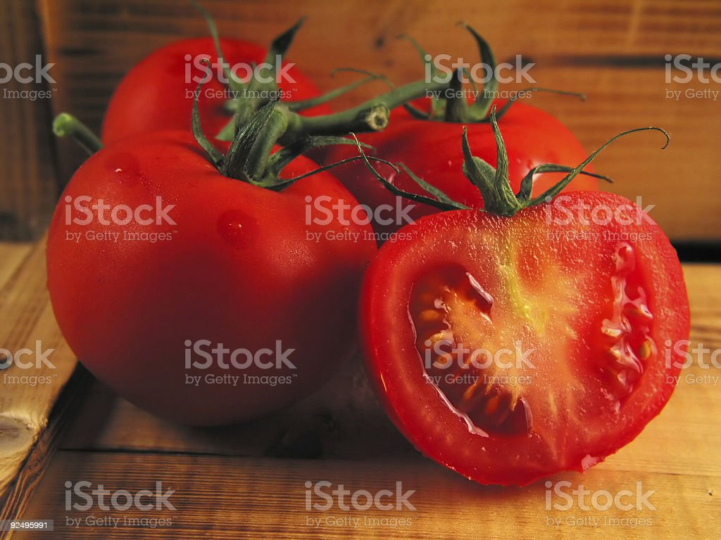 Red tomatoes on wood royalty-free stock photo