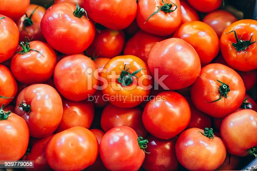 istock red tomatoes texture overhead. background vegetables 939779058