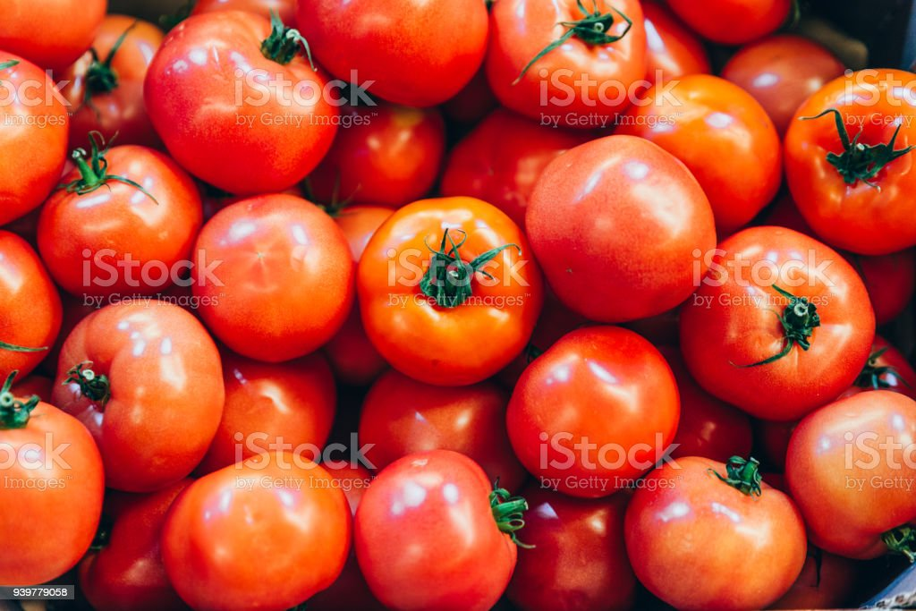 red tomatoes texture overhead. background vegetables stock photo