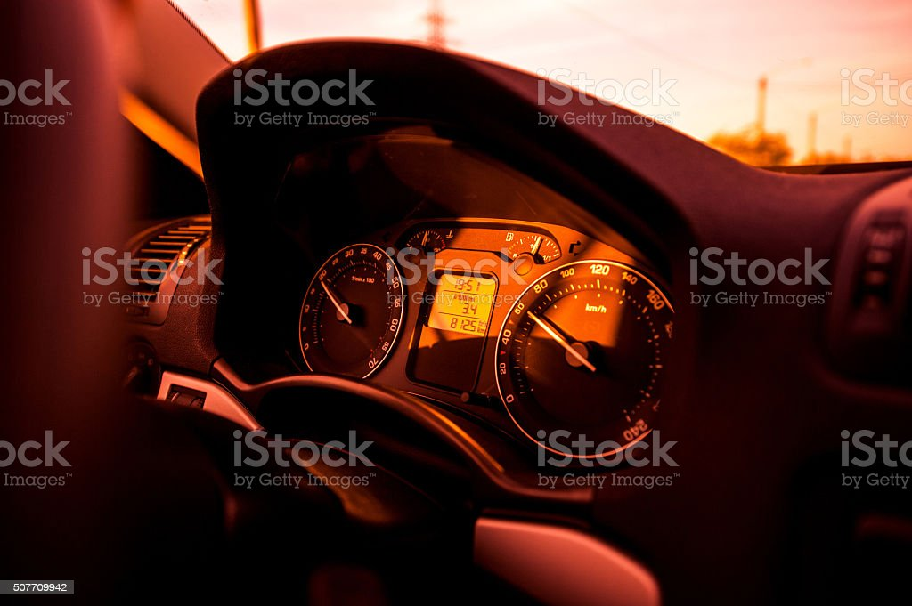 Red tone car dashboard with regular odometer speed stock photo