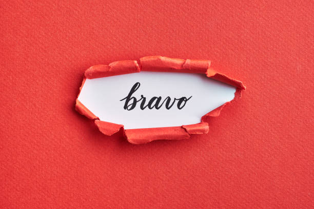 Red torn paper with brush lettering word - bravo stock photo