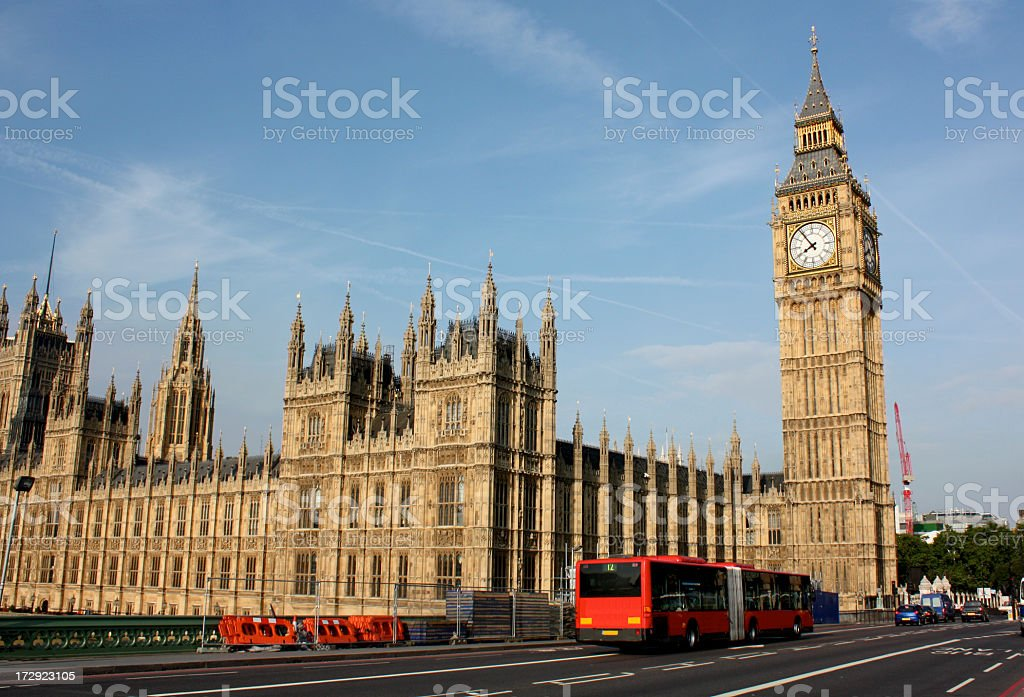 Red tour bus in front of Big Ben and the House of Parliament royalty-free stock photo