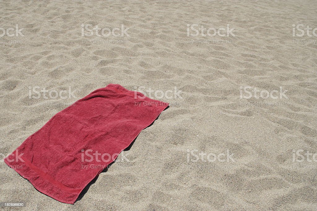 Red towel on sandy beach stock photo