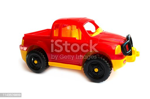 912120622 istock photo red toy car. children's toy. plastic red car 1143526859