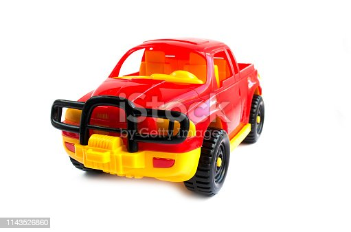 912120622 istock photo red toy car. children's toy. plastic red car 1143526860