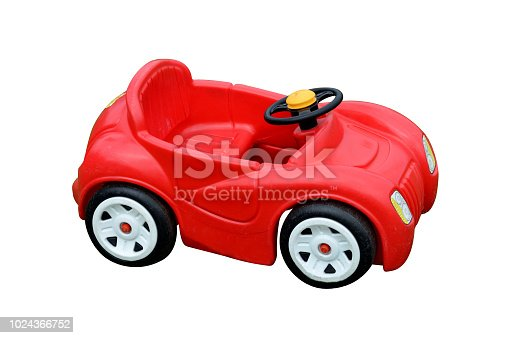 Red toy car isolated on white background. Copy space