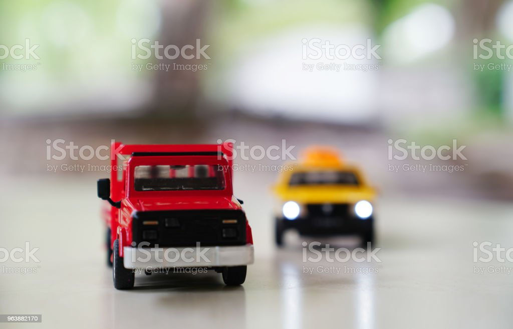 Red toy car truck and yellow old taxi car on road on blurred background,  traffic and drive concept - Royalty-free Bridge - Built Structure Stock Photo