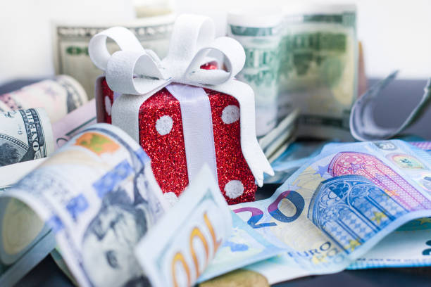 Red Toy Gift Dollars And Euro On Black Background Stock Photo More