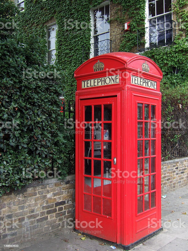 Red traditional British telephone kiosk in East London royalty-free stock photo