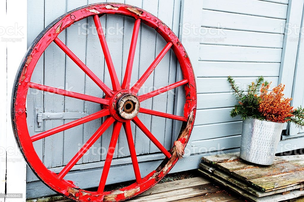 Red traditional wooden wheel royalty-free stock photo