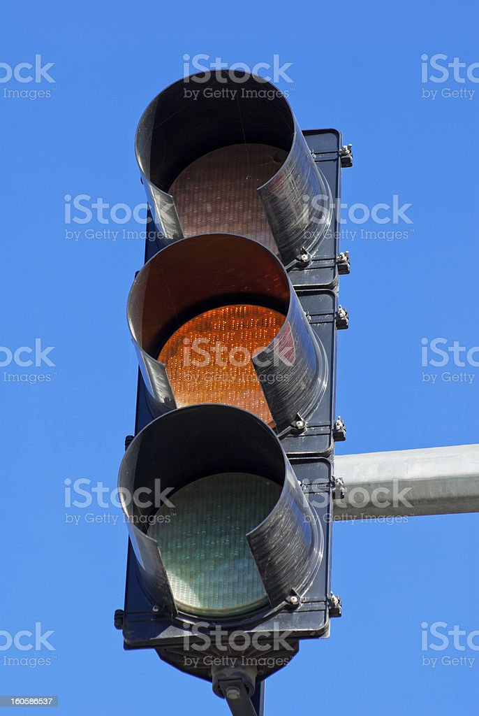 Red traffic light against a bright blue sky royalty-free stock photo