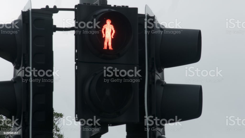 Red traffic light for pedestrian, rules on road, warning signal, restriction stock photo
