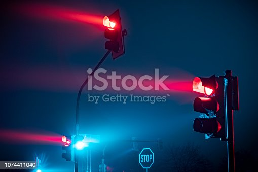 Red traffic light in fog