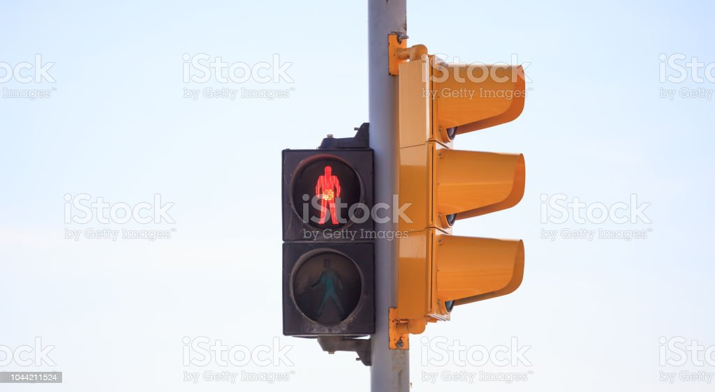 Red traffic light warns pedestrian that is not secure to cross the...