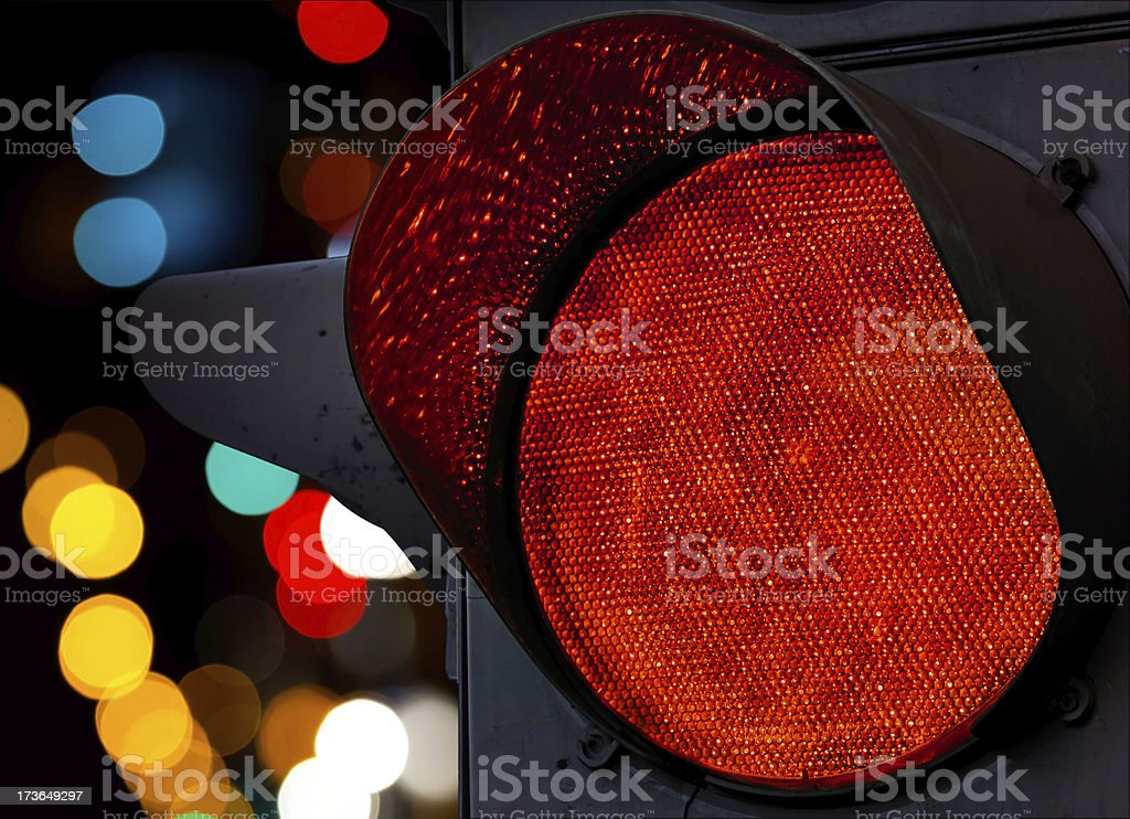 Red traffic light with colorful unfocused lights on a background royalty-free stock photo