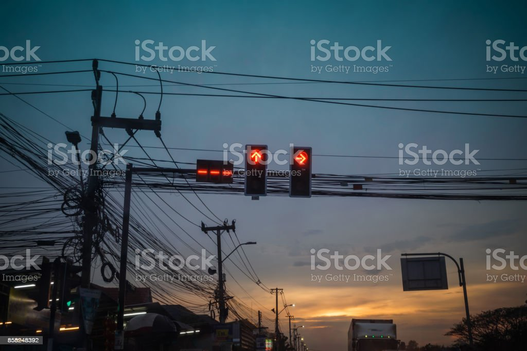 Red traffic light with messy wires on road stock photo