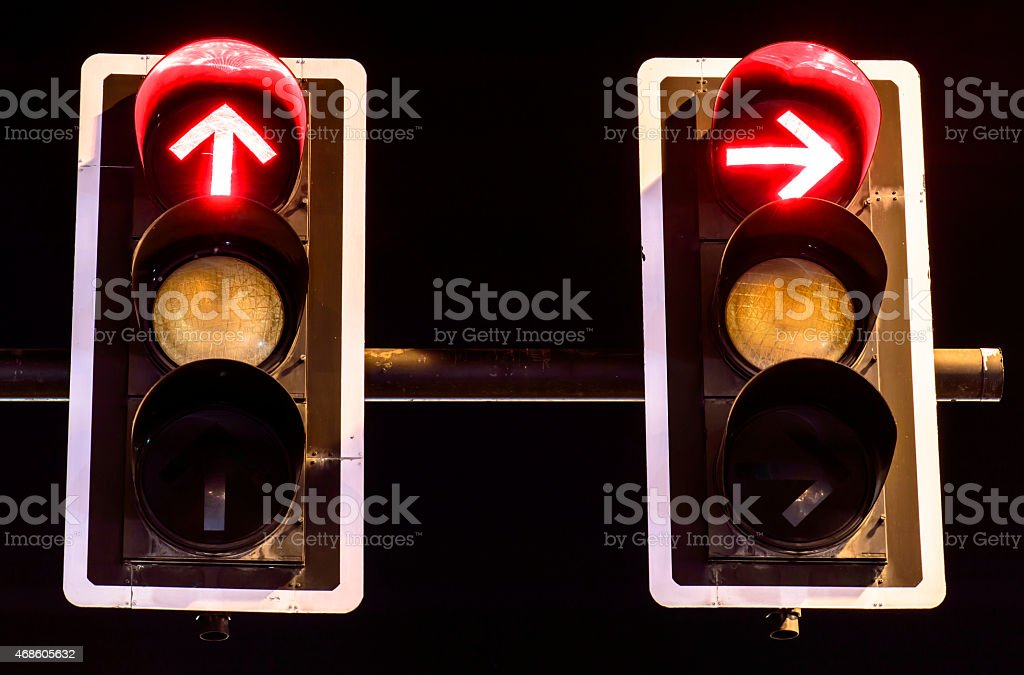 Red traffic lights on night background stock photo