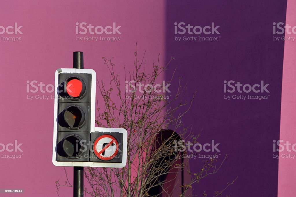 Red traffic lights with no right turn sign stock photo