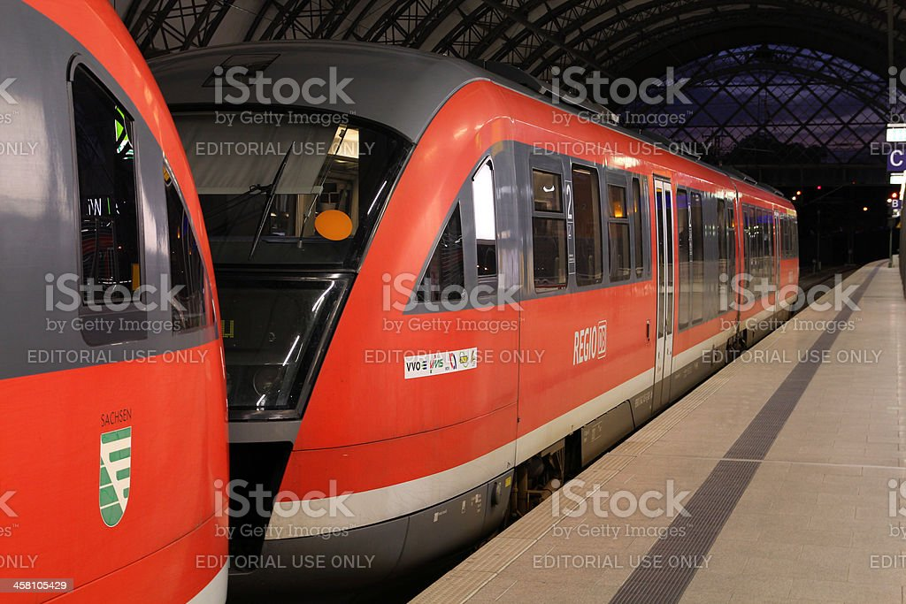 "Red train - Deutsche Bahn ""Dresden, Germany - July 24, 2010: Deutsche Bahn Regio train Siemens Desiro on July 24, 2010 in Dresden, Germany. DB took over Arriva Plc company in August 2010."" Business Stock Photo"