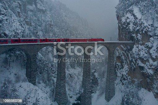 istock Red Train Glacier exoress in the blizzard over Landwasserviadukt in Switzerland 1095580238