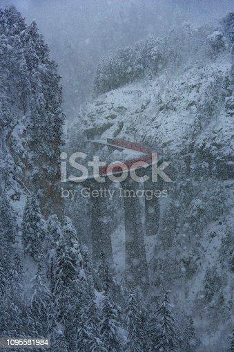 istock Red Train Glacier exoress in the blizzard over Landwasserviadukt in Switzerland 1095581984