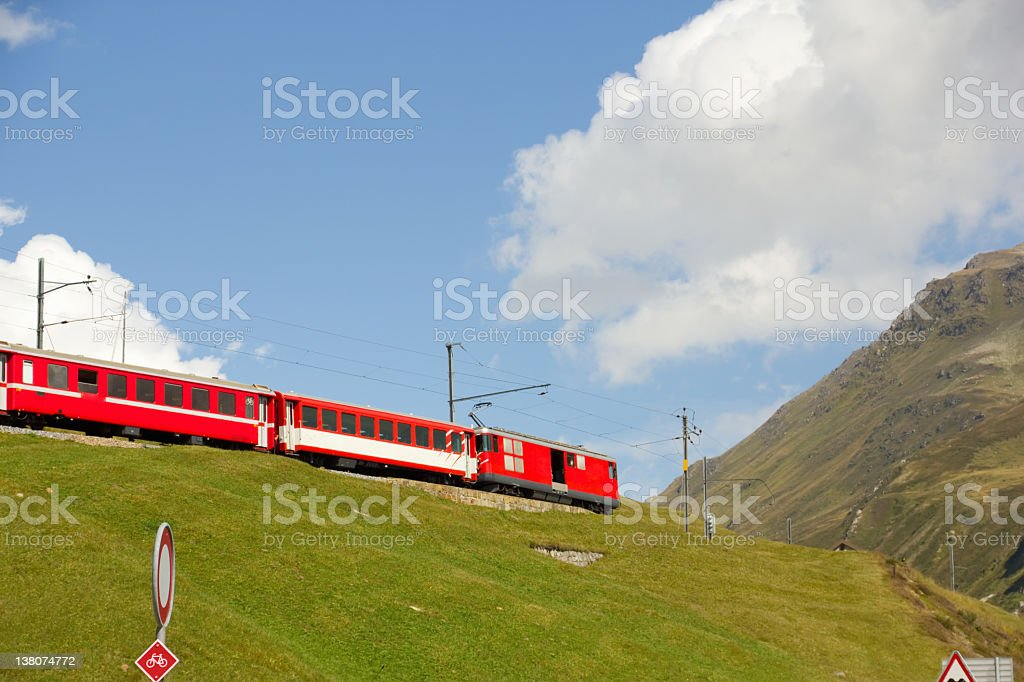Red train in mountains of the Alps royalty-free stock photo