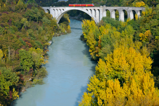 Red Train On Bridge Over Soca River Slovenia Stock Photo - Download Image Now