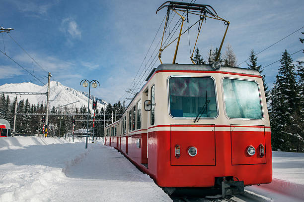 red train on the mountain station in winter - winter austria train bildbanksfoton och bilder