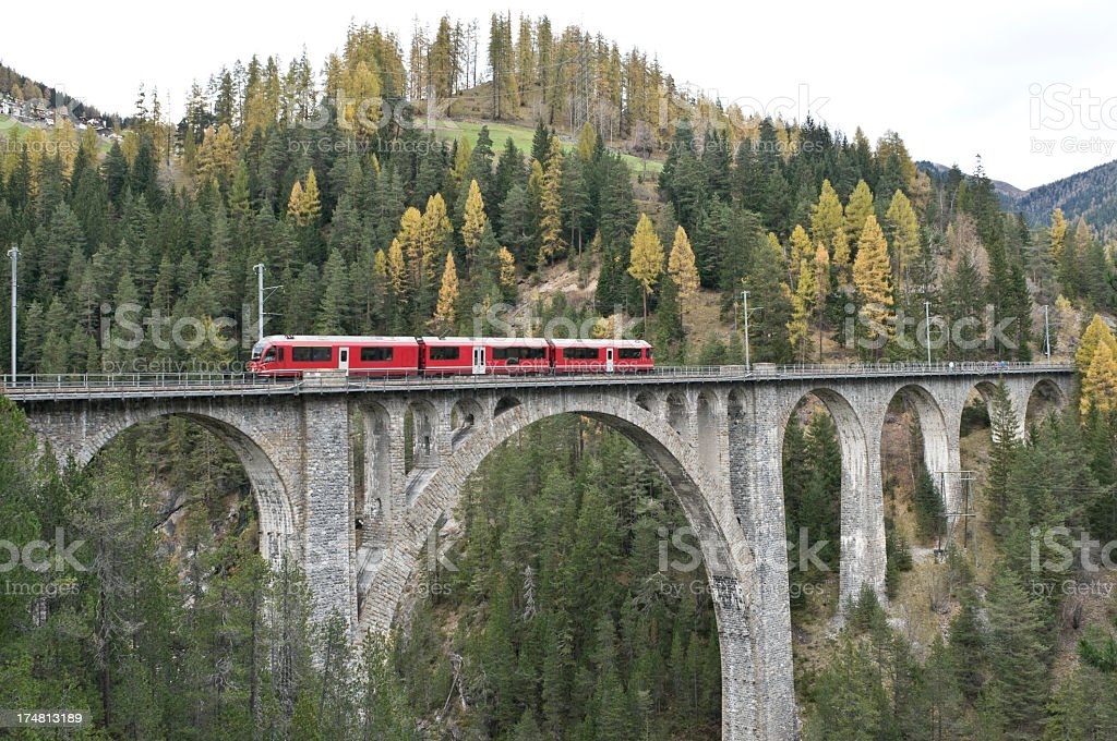 Red train on the Wiesener-Viaduct, Graubuenden, Switzerland stock photo