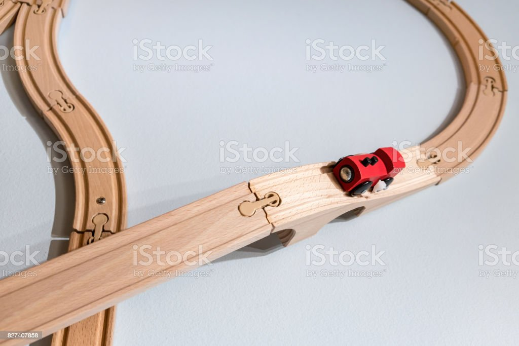 Red train toy on plastic wooden track isolated on white stock photo