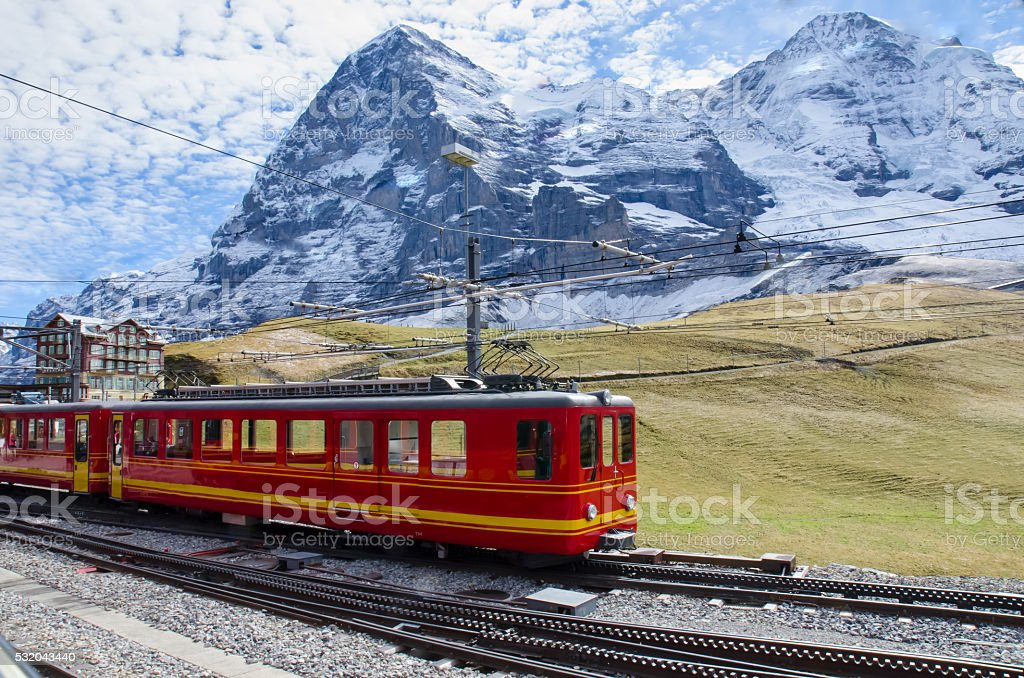 Red Train with Jungfrau Mountain, Switzerland stock photo