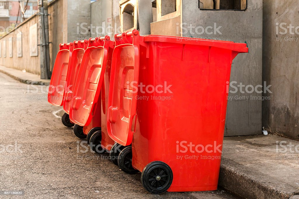 Red trash bins stock photo