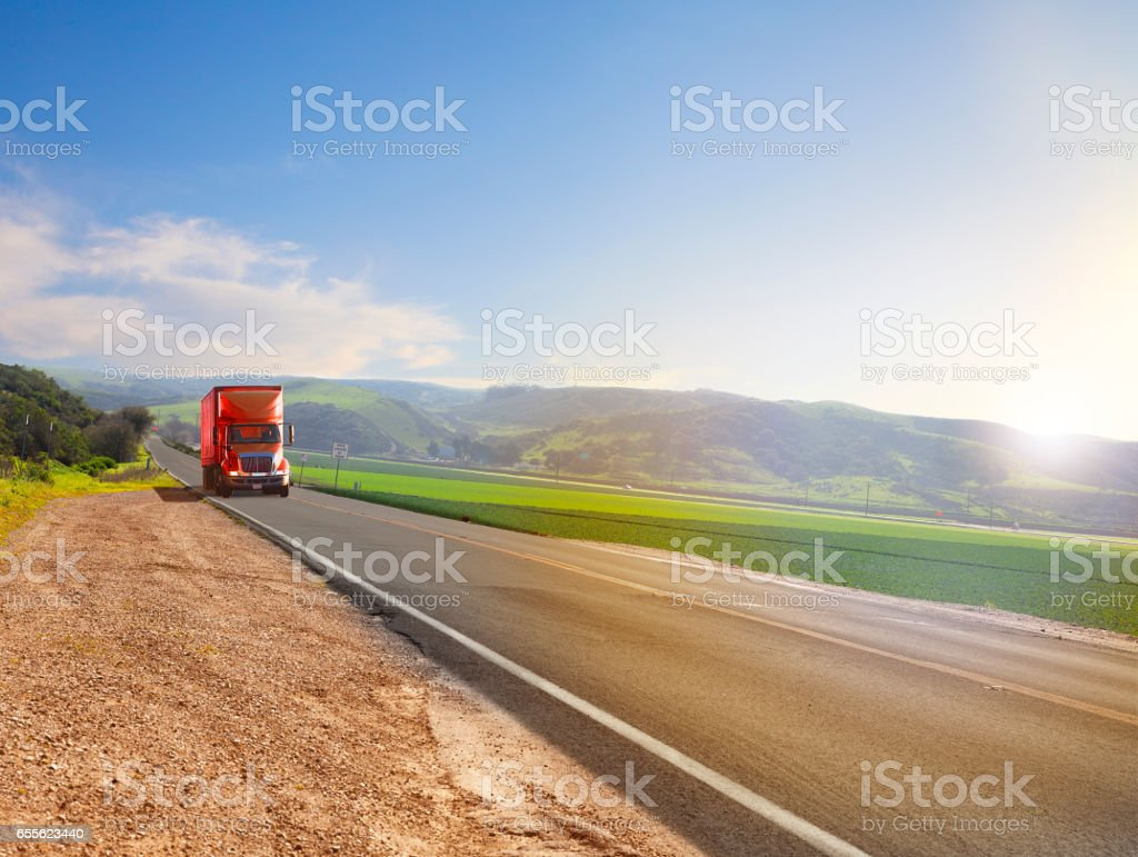 Red Truck on a country road stock photo