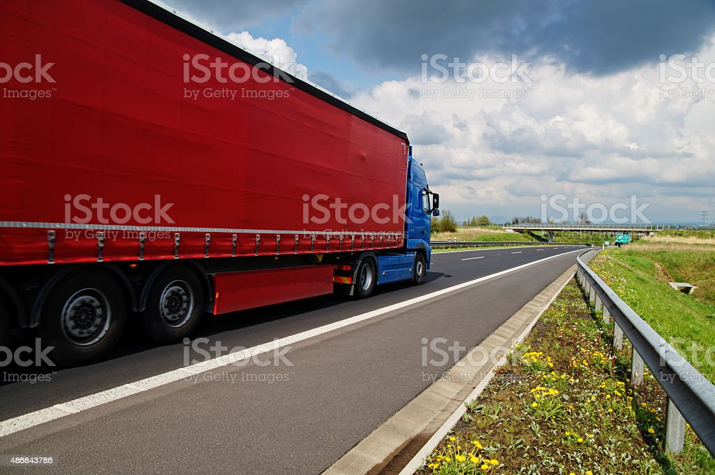 Red truck on asphalt highway. stock photo