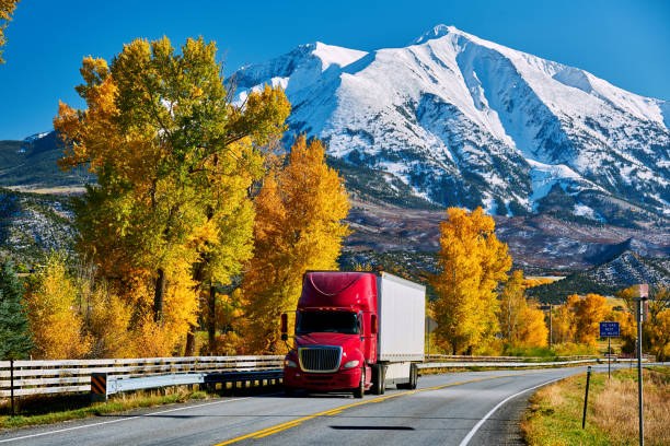 Red truck on highway in Colorado at autumn Red truck on highway in Colorado at autumn, USA. Mount Sopris landscape. rocky mountains north america stock pictures, royalty-free photos & images
