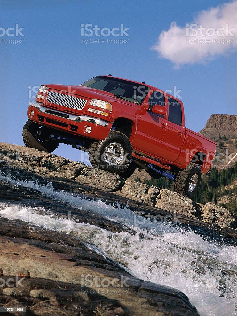 Red Truck on the rocks stock photo