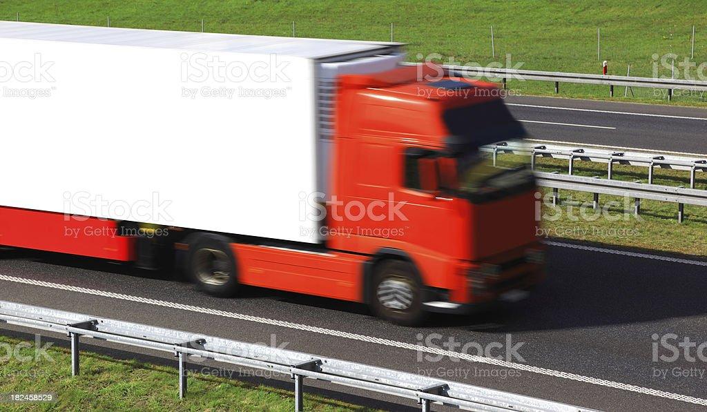 Red Truck Speeding On Highway stock photo