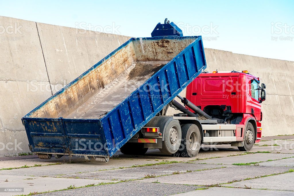 Red truck with a removable container. stock photo