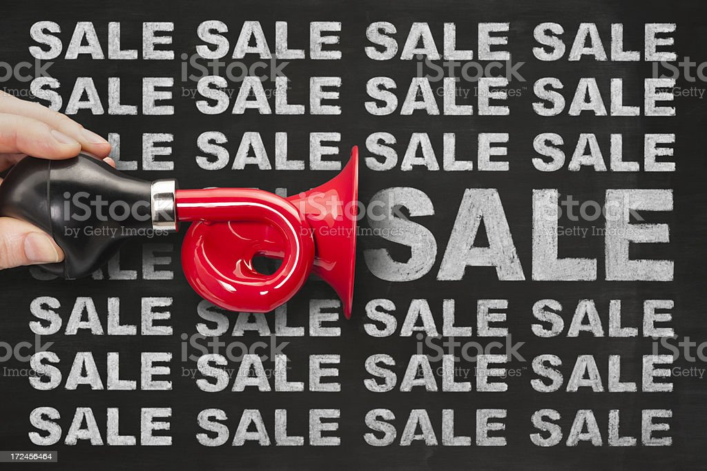 Red trumpet announces SALE royalty-free stock photo