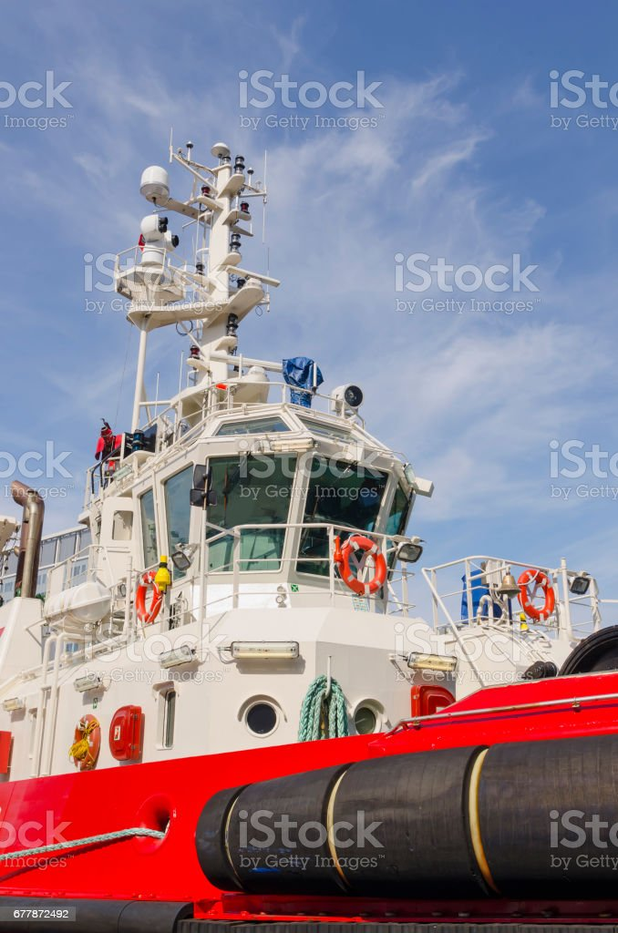 Red tugboat stock photo