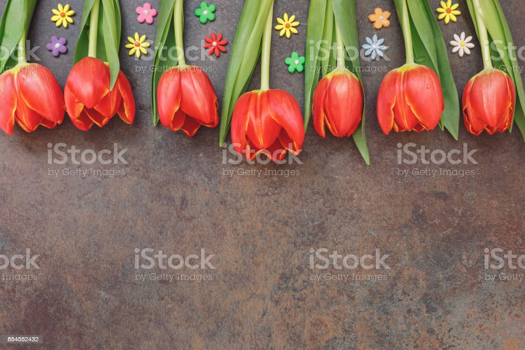 Red tulips and sugar small flower sprinkles stock photo
