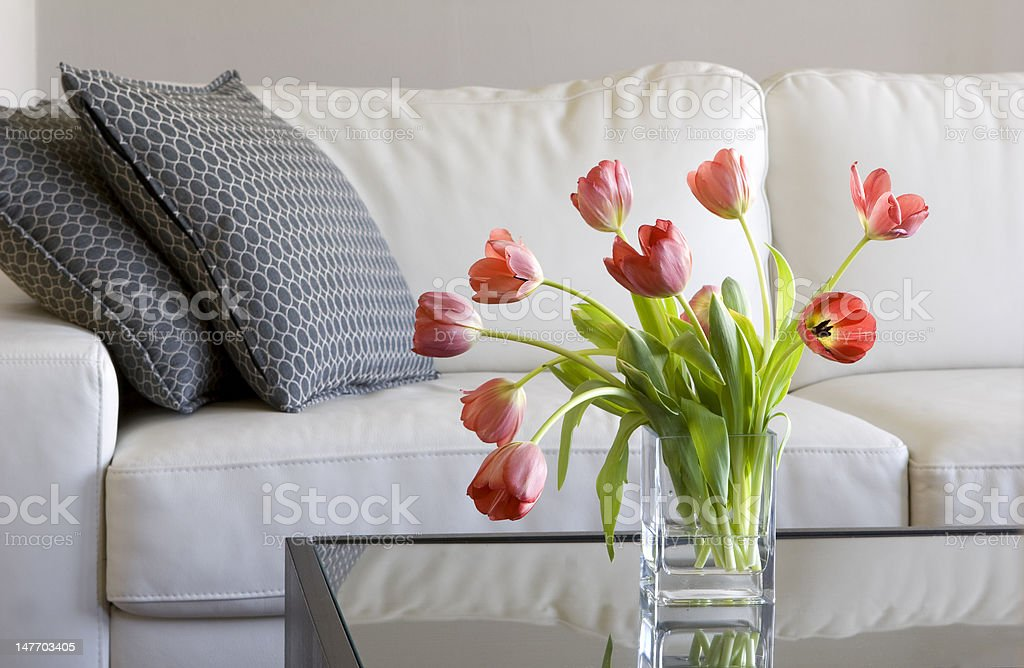red tulips in modern living room - home decor stock photo