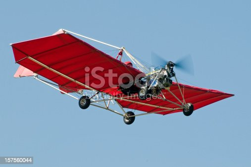 Bright red ultralight aircraft against blue sky. Snedden M7.