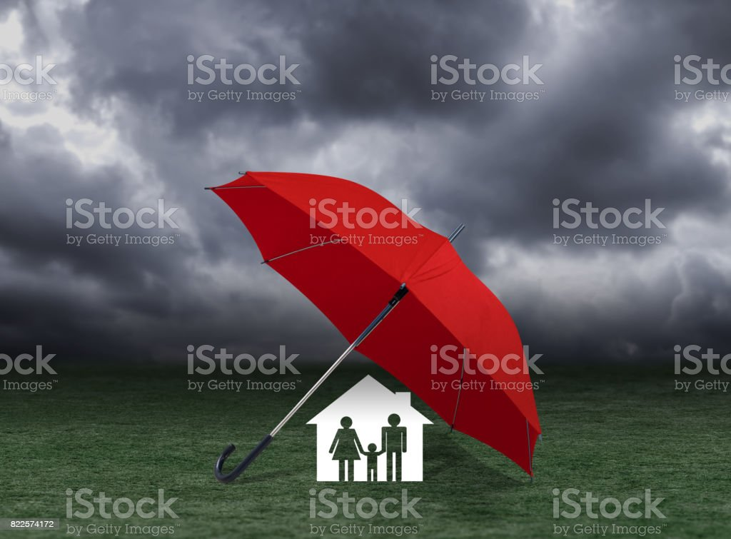 red umbrella covering home and family under rain, insurance concept stock photo