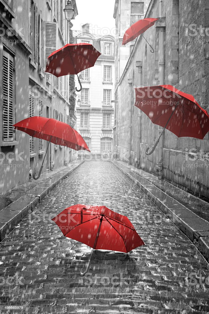 Red umbrellas flying on the street. Conceptual image stock photo