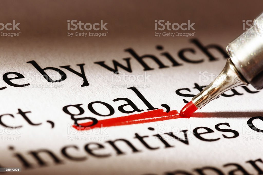 Red underscore emphasizes the word 'goal' in business document royalty-free stock photo