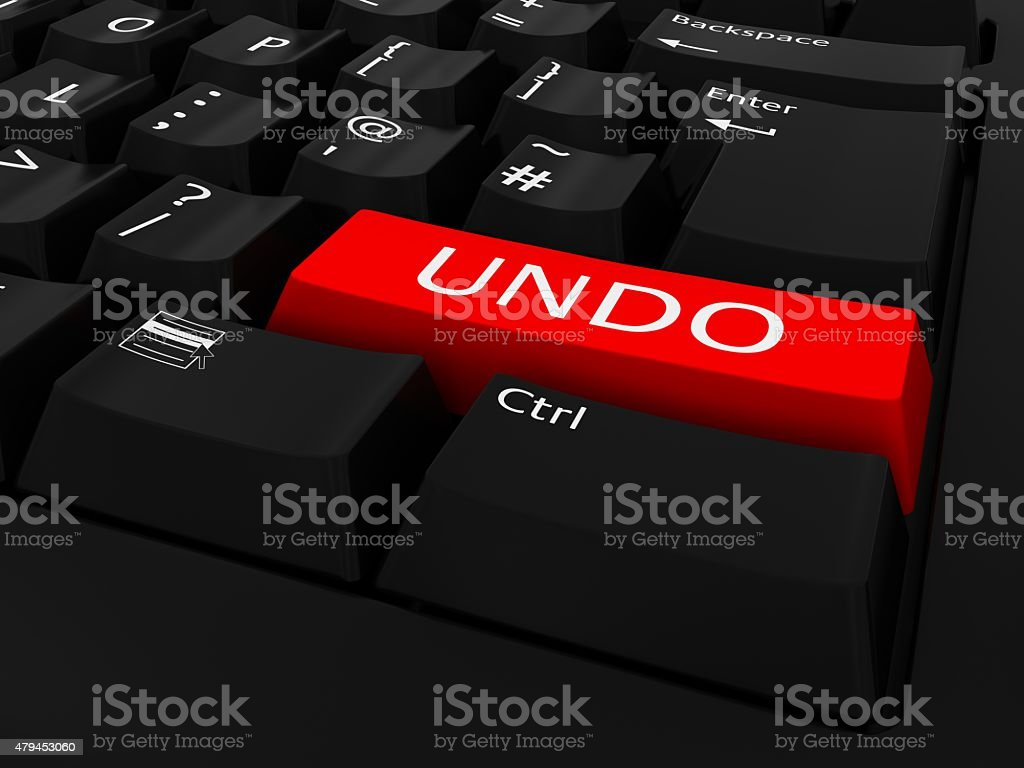 Red UNDO Button on Black Keyboard stock photo