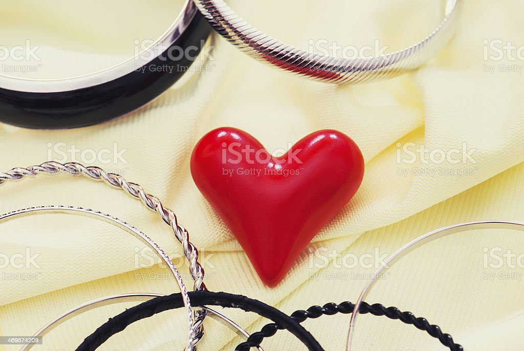 Red valentine heart with various bracelets royalty-free stock photo