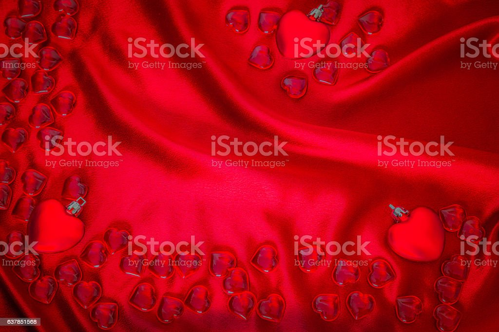 Red Valentine hearts on draped satin coth (P) stock photo